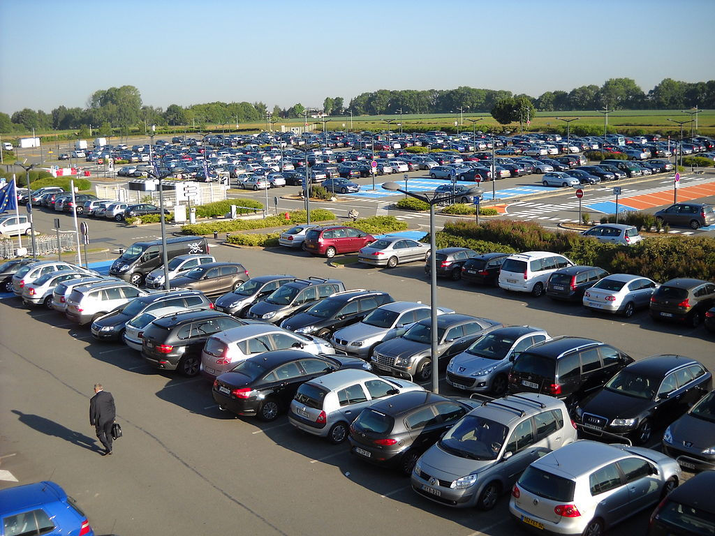 an airport carpark wih lots of parked cars. Click here for the page of booking airport parking deals.