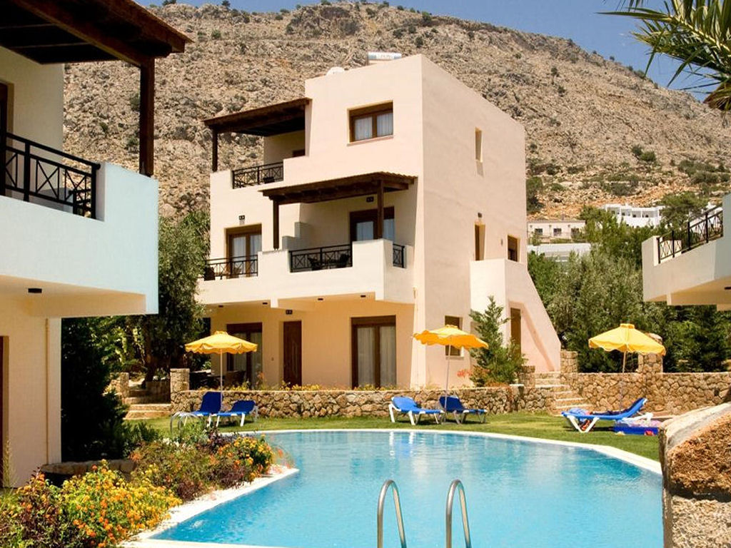 Stone clad holiday villa with pool and grassed sunbathing area. Click here to visit the villa page